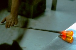 Hot glass being rolled smooth